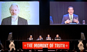 Wikileaks founder Julian Assange appears at the Moment of Truth rally in Auckland via video link